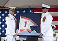 US Navy 100807-N-5539C-048 Capt. Stephen Grzeszczak, left, receives the Naval Special Warfare Unit (NSWU) 1 command pennant from Command Master Chief (SEAL) Terrie McCullah during a change of command ceremony at U.S. Naval Base.jpg
