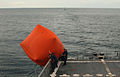 US Navy 101028-N-9156C-073 Sailors aboard the guided-missile frigate USS Commelin (FFG 37) launch an inflatable target.jpg