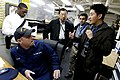 US Navy 101119-N-8863V-143 Tim Zhang, right, confers with U.S. Coast Guard Gunner's Mate 1st Class Jason Keith as Anthony Oyatayo, left, James Chai.jpg