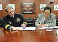 US Navy 110202-N-2858S-085 Capt. Eric Gardner signs a Memorandum of Agreement with Keishu Tanaka in the headquarters building at NAF Atsugi.jpg