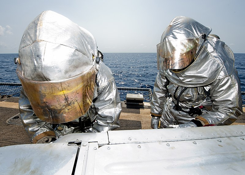 File:US Navy 110726-N-OV802-162 Yeoman Seaman Anthony Williams and Damage Controlman Fireman Paul Bernal wear hot suits while participating in a damage.jpg