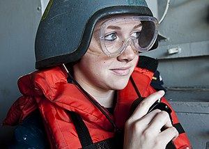 US Navy 111221-N-BT887-178 Seaman Katherine Page, from Dayton, Ohio, uses a sound-powered telephone at a replenishment station aboard the Nimitz-cl.jpg