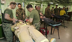 US Navy 111230-N-PB383-092 Hospital corpsmen address simulated casualties during a total ship survivability exercise aboard the amphibious transpor.jpg