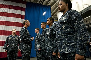 US Navy 120204-N-WS082-227 Chief of Naval Operations (CNO) Adm. Jonathan Greenert speaks with Sailors after holding a reenlistment ceremony aboard.jpg