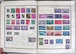 US postage stamps on album pages.jpg
