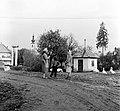 Ulica Obrancov mieru a Poltarica-patak hídjánál, háttérben az evangélikus templom. Fortepan 54013.jpg