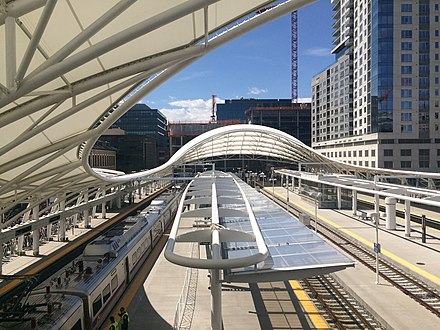 Union Station train shed, designed by Skidmore, Owings & Merrill, on opening day of the A line to DIA. Union Station, Opening Day.jpg