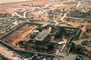 Embassy of the United States, Mogadishu - Left side of the embassy compound in December 1992. The chancery, with its own wall, is in the foreground with the USIS building (bottom right). The JAO building is barely visible in the upper right, with the Marine House to its left (top, right of center). The golf course was beyond the wall in the upper left. When this photo was taken, the embassy compound was being cleared to serve as UNITAF headquarters.