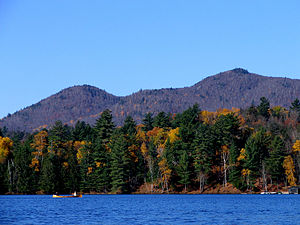Brighton, Franklin County, New York - A guideboat on Upper St. Regis Lake, Saint Regis Mountain behind