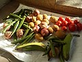 Vegetables okra, potatoes, onions tomatoes and raw banana in sunlight.jpg