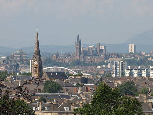 Panorama over Glasgow's South Side and West End from Queen's Park, looking north west. Left of centre can be seen the Clyde Arc bridge at Finnieston, while beyond is the tower of the University of Glasgow, with the Campsie Fells in the distance on the right. View of Glasgow from Queens Park.jpg