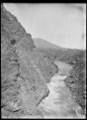 View of a river with steep cliffs on the left hand side with a grassy plateau in the distance. ATLIB 294498.png