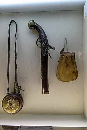 Muzzleloader - 18th-century flintlock pistol with powder flask and bag of balls