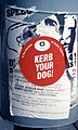 Waste receptacle in England with sign Kerb Your Dog.jpg