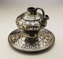 Decorated metal vase