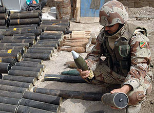 2008 in Iraq - An Iraqi soldier from the 1st QRF division examines a mortar captured during clearing operations in Hayaniya, 19 April