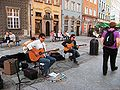 Wikimania 2010 - Guitar players in the main street.jpg