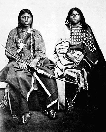 A Kiowa couple. The woman on the right is wearing an elk tooth dress. William S. Soule - Eonah-pah and Wife.jpg