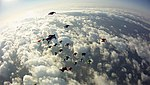 Wingsuit Vertical Formation Record (6367544307).jpg