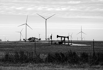 Pickens Plan - Wind turbines generate electricity behind a pumpjack in Muenster, Texas. This could be a common scene in the Great Plains if Pickens Plan is adopted.