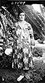 Woman posed in a garden (3525671865).jpg