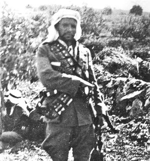 Yusuf Abu Durra - Abu Durra posing with his rifle, 1936
