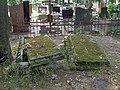 Łódź-old, damaged graves at Old Cemetery.jpg