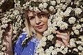 День Вишиванки. Молода україночка у вишитій синій сукні серед квітів 10.jpg