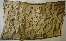 A sculpted scene from Trajan's Column of Roman cavalry fighting Sarmatian cavalry.