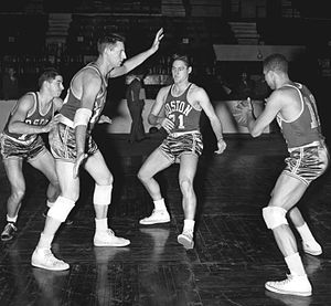 Chuck Cooper (basketball) - The 1953–54 Boston Celtics basketball team practicing the pick and roll. From left to rightː Bob Donham, Ed Mikan, Bill Sharman and Chuck Cooper