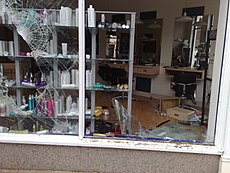 Various buildings in Birmingham have been damaged by rioting, including this hairdressing shop. Image: Clare Lovell.
