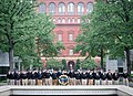 2015 Law Enforcement Explorers Conference posing with wreath and building behind.jpg