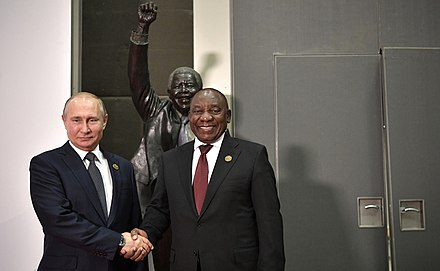 Russian President Vladimir Putin and South African President Cyril Ramaphosa in front of a Mandela statue 2018 BRICS summit (2).jpg