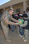 407th AEG hands out school supplies DVIDS76626.jpg