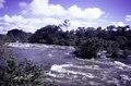ASC Leiden - F. van der Kraaij Collection - 05 - 103 - A foamy river with rapids, bushes and trees - Liberia, 1976.tif