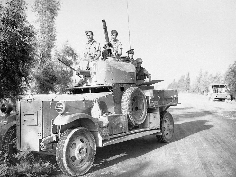 A Fordson Armoured Car of No. 2 Armoured Car Company RAF waits outside Baghdad, while negotiations for an armistice take place between British officials and the rebel government during the Iraqi Revolt, May 194 CM923