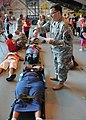 A New York Air National Guardsman, right, triages a simulated victim during exercise Golden Eagle III at Stewart Air National Guard Base, Newburgh, N.Y., June 1, 2013 130601-Z-VX101-046.jpg