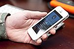 A cell phone displays an application designed by U.S. Airmen supporting Joint Task Force-National Capital Region 130116-A-MZ229-001.jpg