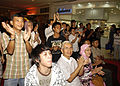 "A crowd of hundreds applauds the U.S. 7th Fleet rock band Orient Express after the band's rendition of ""Hotel California"" during a concert at Artha Gading Mall Aug. 26, 2009, in Jakarta, Indonesia 090826-M-VP123-067.jpg"
