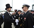 A guest dressed as Abraham Lincoln attend the commissioning ceremony of USS Illinois (SSN 786) (30013821313).jpg
