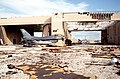 A pair of F-16 Fighting Falcons which were left in the alert complex lay destroyed after the hangar they were stored in was destroyed by Hurricane Andrew - DPLA - f1568441185f34e2ead8098bcae0696d.jpeg