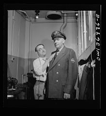 A tailor fitting a coat at the shop maintained in the Greyhound garage. 8d32804v.jpg