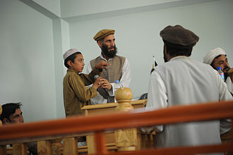 Law of Afghanistan - A young plaintiff testifying during a public criminal trial in 2011 at a courthouse in Asadabad, Afghanistan