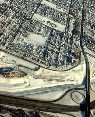 Radisson Heights, Calgary - Aerial view of Albert Park in winter, with Max Bell Center