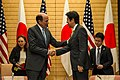 Ambassador Roos with Prime Minister Abe at the Joint Press Announcement of the Okinawa Consolidation Plan (8621946216).jpg