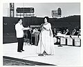 An unidentified woman sings with a band in Fenway Park (13854567354).jpg