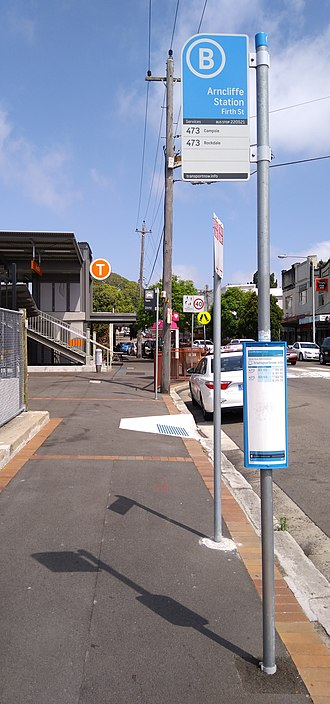 Buses in Sydney - Bus, train and taxi signage at Arncliffe railway station adheres to the guidelines set by Transport for NSW.