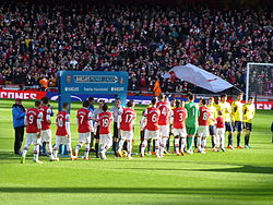5f2e1e223 Arsenal players shaking hands with their Sunderland counterparts before  their Premier League match on 22 February 2014.