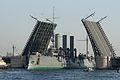 Aurora cruiser passes under opened Palace Bridge.jpg