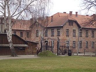 """Rudolf Vrba - Auschwitz I, 2008, with its Arbeit Macht Frei slogan (""""work sets you free"""") above the gate"""